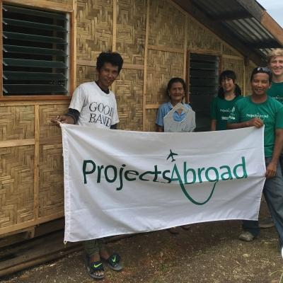 Projects Abroad volunteers take part in building volunteer work in the Phillippines to help construct water sanitation building